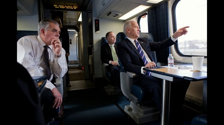 Joe Biden on a train with Transportation Secretary Ray LaHood