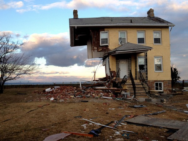 A house in Union Beach, N.J., cut in half by Hurricane Sandy. Image via spleeness/Flickr.