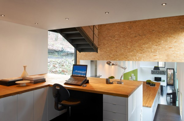 Exposed oriented strand board is seen above office and kitchen area. Image by Steven Massart via AST 77