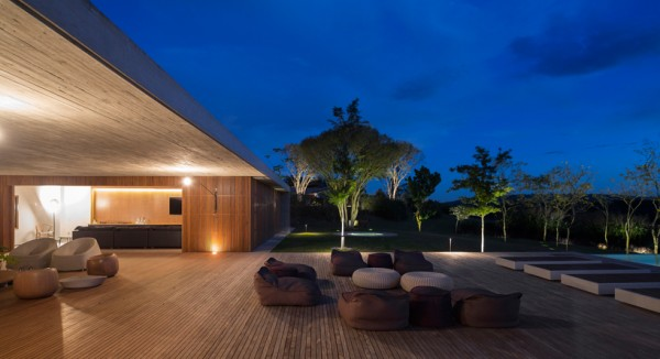 Open-air patio at night. Image via Studio MK27.