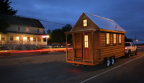 Many models offered by Tumbleweed, such as this Lusby model, measure less than 120 square feet and can fit on a standard trailer for easy transport. Image via Tumbleweed Tiny House Co.
