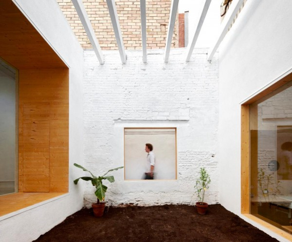 Open courtyard in Barcelona's MAIO Studio allows natural light to flood the artist's spaces. Image by José Hevia via MAIO.