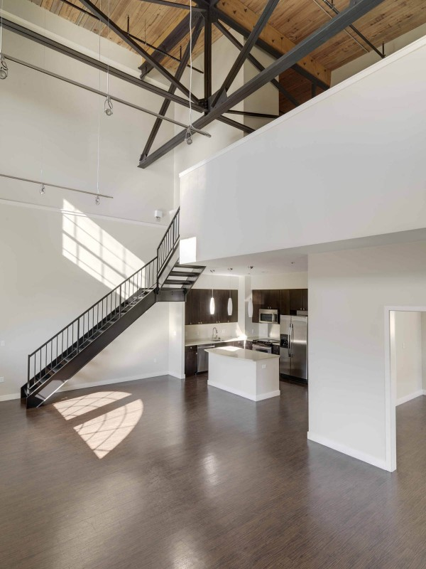 The final phase of the Baker complex renovation includes 17 Watermill Lofts, located in the factory's former boiler room. Image via PRWeb.