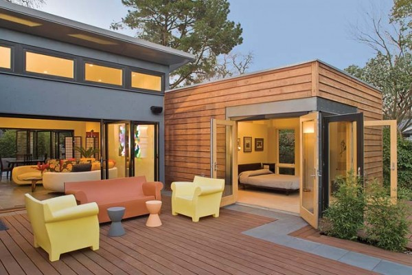 An example of the folding-door feature to bring in tropical breezes. Image via Blu Homes.
