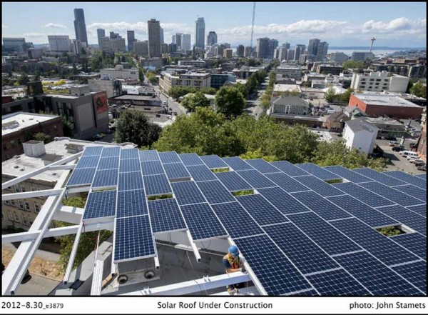 A view of the Seattle skyline from the roof-mounted solar array. Image via Bullitt Foundation.