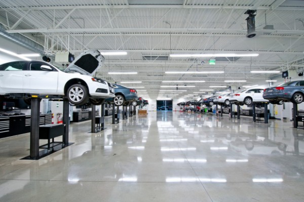 The two-story Audi dealership includes 22 spotless service bays. Image via Audi Pacific.