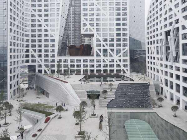 The vast central meeting space amid the LEED Gold-certified complex. Image via Steven Holl Architects.
