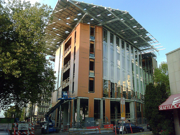 "So far, 15 different projects, from New York State to Hawaii, have been certified as ""Living Buildings."" The likely 16th is Seattle's Bullitt Center (pictured here in progress), a six-story solar-powered ""net zero"" building designed to make extensive reuse of rainwater and day lighting and which features many other green amenities. (image credit: Joe Wolf, Flickr)"