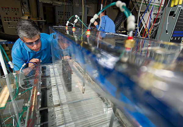 NREL engineers Eric Kozubal, left, and Jason Woods conduct research on a DEVAP prototype at the HVAC Systems Laboratory.(image credit: Dennis Schroeder/NREL)
