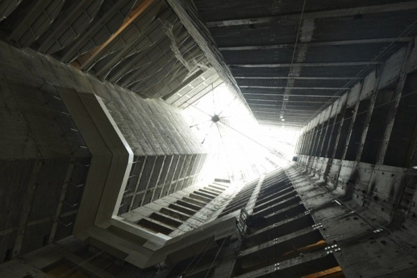 A vertical view up through the central atrium during constructions shows how natural light will be drawn into the interior. Image via SOM.