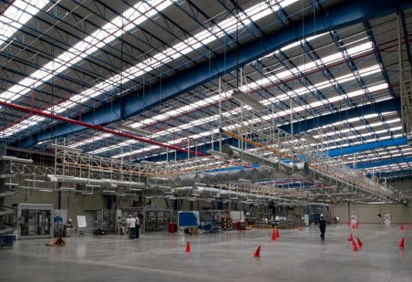The high ceiling inside the Jiutepec plant includes skylights to bring natural daylight into the interior. Image via Unilever.
