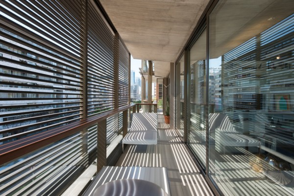 A closeup view of the wooden louvers on the apartment balconies. Image by Nigel Young via Faena Group.