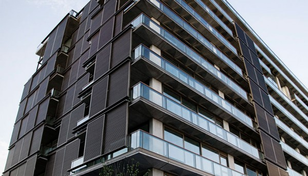 The Aleph Residences in Buenos Aires, Argentina, showing sliding wooden panels to control solar gain. Image via Faena Group.