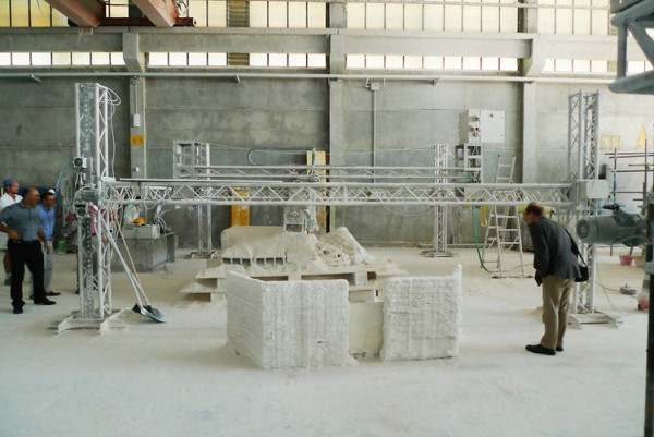 Testing the construction of prototype Moon base walls using Monolite's D-Shaped Printer device. Image via the European Space Agency.