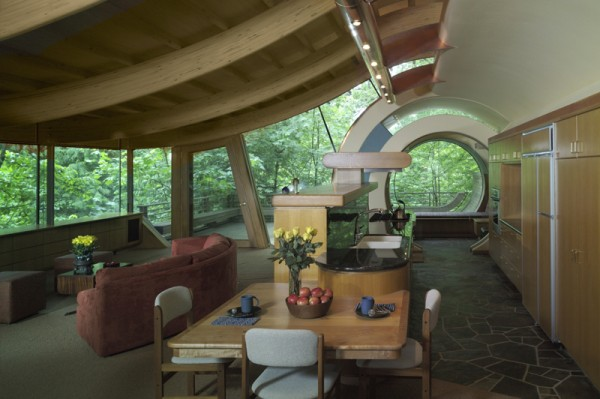 The interior of the Wilkinson House shows the swooping roof and signature circular main entrance. Image by Cameron Neilson via Robert Oshatz.