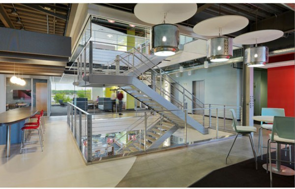 "A ""collaboration zone"" in between two of the floors of the Whirlpool campus, featuring an open staircase. Image by James Steinkamp via Interior Architects."