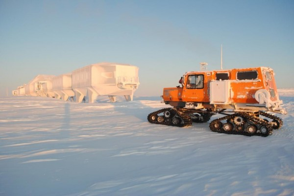 Seen here after being completely iced over, the Halley VI units can be moved as needed by Sno-cat vehicles. Image by James Goby via BAS.