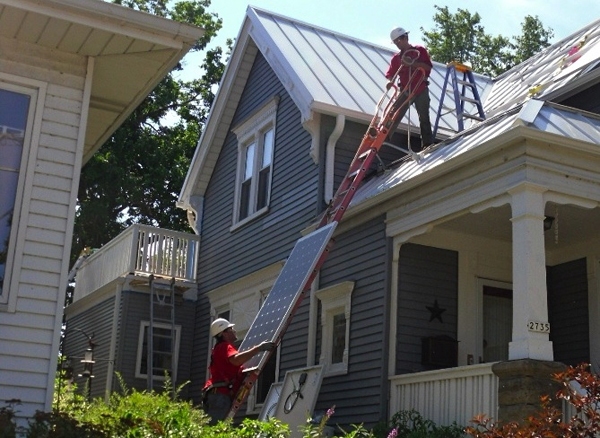 Milwaukee solar installers putting in a rooftop solar energy system on Dr. Paula Papanek's home. (image via Dr. Paula Papanek/DOE)