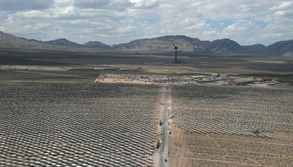 Under Ken Salazar, the Interior Department aggressively pursued renewable energy development, like the Ivanpah solar power plant shown here, on public lands. (image via BrightSource Energy)