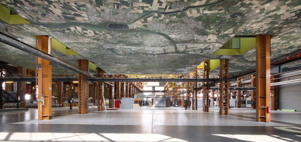 "Underneath the meeting rooms, a Google Maps image of Rotterdam emphasizes the ""city within a building"" concept. Image by Theo Peekstok via Groosman Partners."