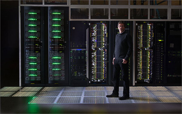 Steve Hammond, director of NREL's Computational Science Center, stands in front of air-cooled racks in the high performance computing (HPC) data center in the Energy Systems Integration Facility (ESIF). The rest of the system will be built out this summer using warm-water liquid cooling to reach an annualized average power usage effectiveness (PUE) rating of 1.06 or better. (image via NREL)