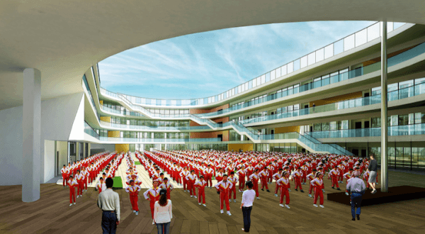 The oval shape also creates a central courtyard for assemblies and other activities. Image via LYCS Architecture.