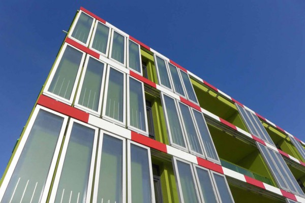 The glass panels of the BIQ House contain bio-reactors powered by algal growth. Image via Arup.