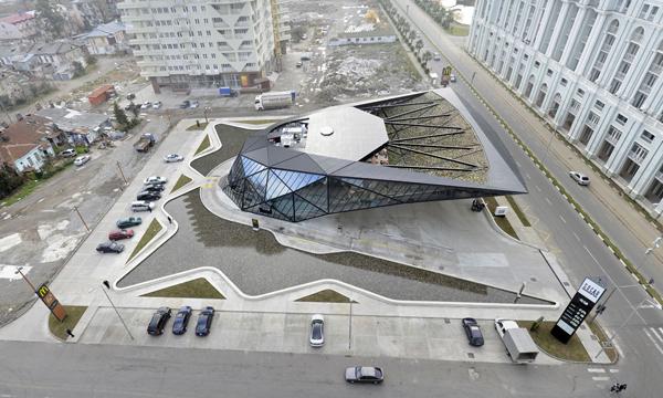 Aerial view of site shows the twin water features incorporated into the landscaping. Image via Giorgi Khmaladze.