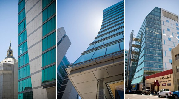 Views of the building's glazed exterior and wind power array. Image via KMD Architects.