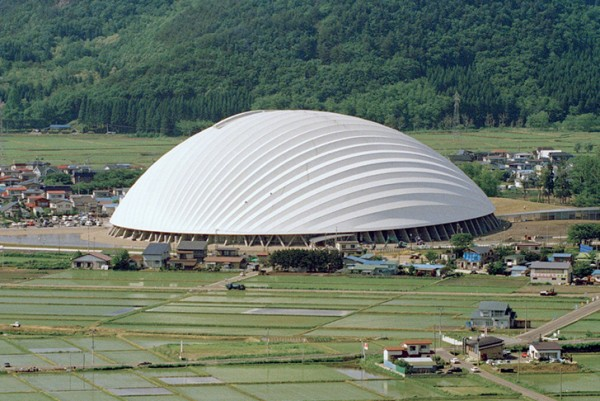 Toyo Ito's Odate Dome appears to float like a soap bubble among rice paddies in Japan. Image by Mikio Kamaya via Toyo Ito & Associates.