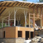 The Underhill Residence under construction, showing the round-wood timbers and y-shaped natural support posts. Image via WholeTrees Architecture & Structures.