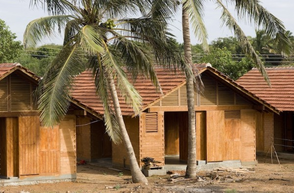 The new units are built with compressed earthen blocks and local rubber tree wood. Image by Dominic Samsoni via Shigeru Ban Architects.