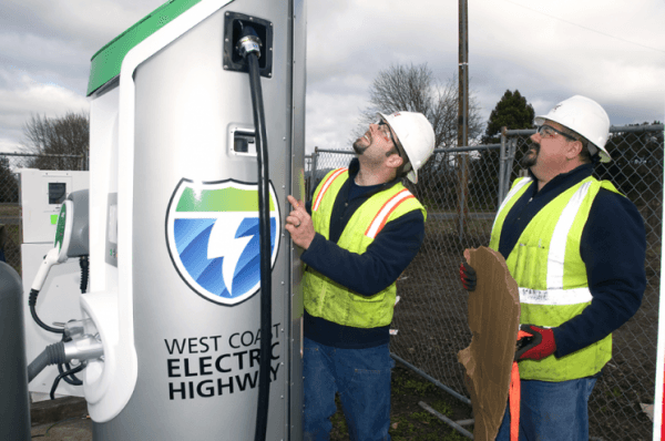 Workers put the finishing touches on installing a plug-in electric vehicle charger that is part of the West Coast Electric Highway. (image via Columbia-Willamette Clean Cities Coalition)