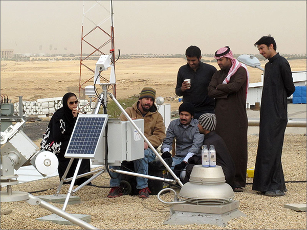 Mike Dooraghi works with engineers from K.A.CARE to install a rotating shadowband radiometer at the Al-Uyaynah Research Station near Riyadh. (image credit: Steve Wilcox/NREL)