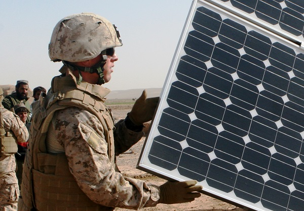 Solar is making its way to the battlefield – here as part of a water purification system in Afghanistan – but the much bigger use is to power domestic bases and other facilities, including housing. (image via U.S. Marines)