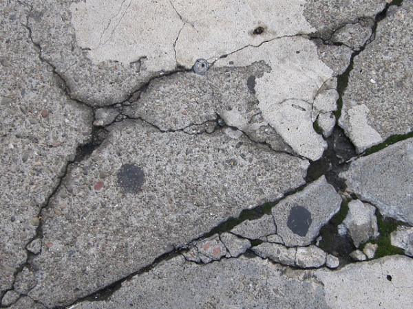 Bacteria may someday help heal large cracks as these before the have a chance to widen and require expensive fillers. Image by Shaire Productions via Flickr.