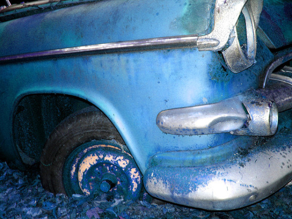 An abandoned Chrysler (image via Curtis Perry/Flickr)
