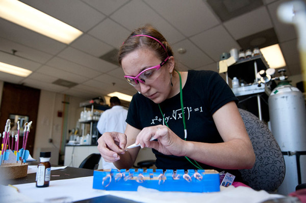 NREL intern Erin Brahm builds electrodes to be used for hydrogen research at NREL's hydrogen lab. (image via NREL)