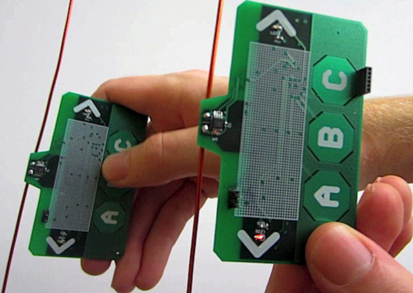 Using ambient backscatter, these devices can interact with users and communicate with each other without using batteries. They exchange information by reflecting or absorbing pre-existing radio signals. (image via University of Washington)