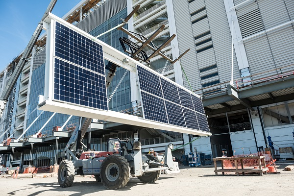 A solar panel frames is lifted to the rooftop of suites building at Levi's Stadium. (image via NRG Energy)