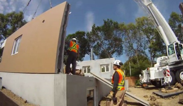 Putting the panels in place. (image from Habitat for Humanity Edmonton video)